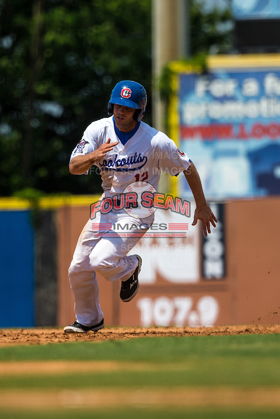 Stephen Wickens (12) of the Chattanooga Lookouts runs during a game between the Jackson Generals and Chattanooga Lookouts at AT&T Field on May 10, 2015 in Chattanooga, Tennessee. (Brace Hemmelgarn/Four Seam Images)