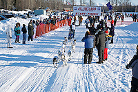Saturday, February 24th, Knik, Alaska.  Jr. Iditarod musher Amanda Olson leaves start line on Knik Lake
