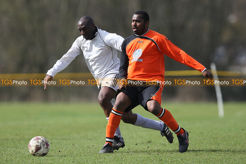 St Lucia United (orange) vs Rolls Park - East London Sunday League Senior Cup Semi-Final Football at South Marsh, Hackney Marshes, London - 18/03/12 - MANDATORY CREDIT: Gavin Ellis/TGSPHOTO - Self billing applies where appropriate - 0845 094 6026 - contact@tgsphoto.co.uk - NO UNPAID USE.