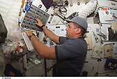 FILE: In this photo released by NASA, Astronaut William A. (Bill) Oefelein, STS-116 pilot, works at a control panel on the middeck of Space Shuttle Discovery during flight day two activities in Earth orbit on December 10, 2006.<br /> Credit: NASA via CNP
