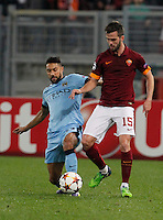 Manchester City's Gael Clichyand  AS Roma's Miralem Pjanic   during the Champions League Group E soccer match between As Roma and Manchester City  at the Olympic Stadium in Rome December 10 , 2014.