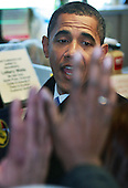 Chicago, Il - November 21, 2008 -- United States President-elect Barack Obama greets customers at Manny's Coffee Shop and Deli during a lunch break from his transition office at the federal building, Friday, November 21, 2008 in Chicago, Illinois. Obama ordered a corned beef sandwich and greeted customers before leaving the restaurant. .Credit: Scott Olson - Pool via CNP
