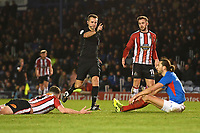 Referee Tom Nield points to the penalty spot after Christian Burgess of Portsmouth right fouled Jordan Hulme of Altrincham  during Portsmouth vs Altrincham, Emirates FA Cup Football at Fratton Park on 30th November 2019