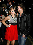 "HOLLYWOOD, CA. - November 17: Actress/Singer Miley Cyrus and Musician Billy Ray Cyrus arrive at the World Premiere of Walt Disney's ""Bolt"" at the El Capitan Theatre on November 17, 2008 in Hollywood California."