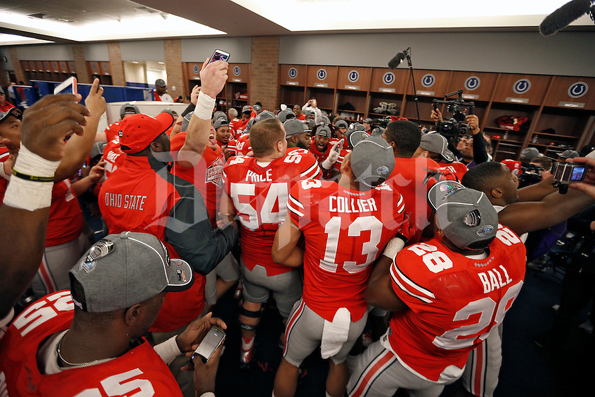 Ohio State Buckeyes celebrate after beating Wisconsin Badgers in the 2014 Big Ten Football Championship Game at Lucas Oil Stadium in Indianapolis, Ind. on December 6, 2014.  (Dispatch photo by Kyle Robertson)
