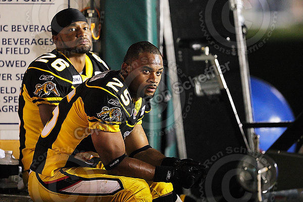 July 31, 2009; Hamilton, ON, CAN; Hamilton Tiger-Cats defensive back Chris Thompson (26) linebacker Markeith Knowlton (25). CFL football: BC Lions vs. Hamilton Tiger-Cats at Ivor Wynne Stadium. The Tiger-Cats defeated the Lions 30-18. Mandatory Credit: Ron Scheffler. Copyright (c) 2009 Ron Scheffler.
