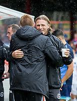 Wycombe Wanderers Manager Gareth Ainsworth embraces Aldershot Town Manager Gary Waddock ahead of the pre season friendly match between Aldershot Town and Wycombe Wanderers at the EBB Stadium, Aldershot, England on 22 July 2017. Photo by Andy Rowland.