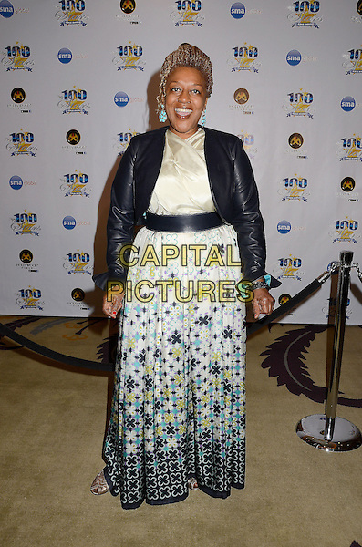 CCH Pounder.23nd Annual Night of 100 Stars Awards Gala hosted by Norby Walters celebrating the 85th Annual Academy Awards held at the Beverly Hills Hotel, Beverly Hills, California, USA..February 24th, 2013.full length black dress blue green print maxi leather jacket.CAP/ADM/BT.©Birdie Thompson/AdMedia/Capital Pictures.
