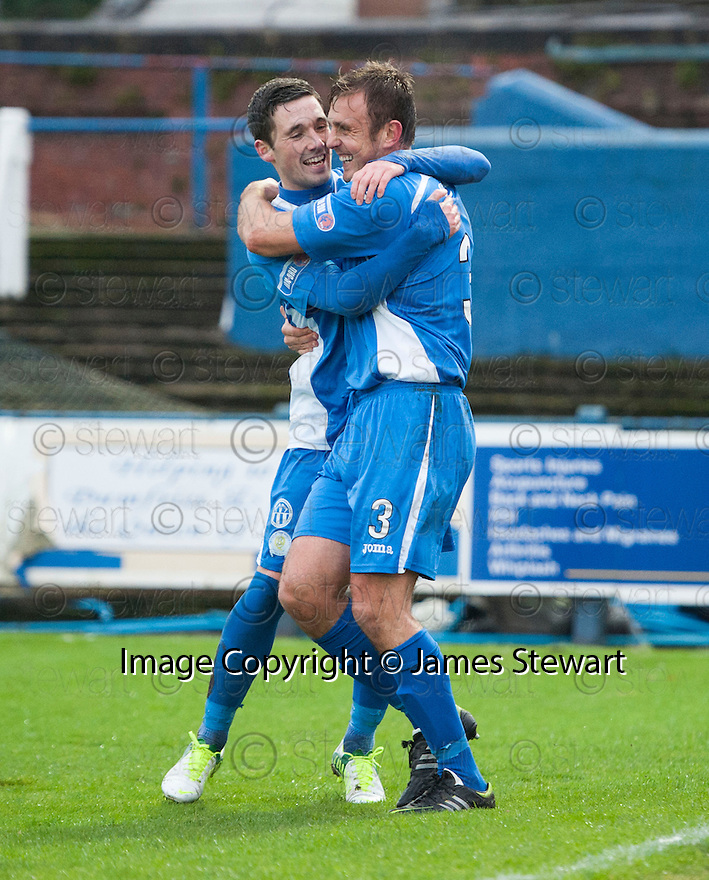 Queen of the South's Ryan McGuffie (3) is congratulated by Queen of the South's Nicky Clark after he scores their first goal.