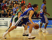 Hugh Quinlivan goes past Piers Finch during the NBL Round 14 match between the Manawatu Jets  and Wellington Saints. Arena Manawatu, Palmerston North, New Zealand on Saturday 31 May 2008. Photo: Dave Lintott / lintottphoto.co.nz