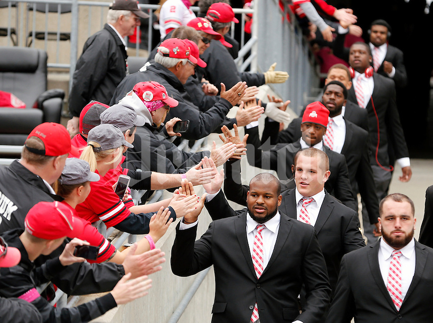 "Ohio State Buckeyes football team enter Ohio Stadium before their game against Rutgers Scarlet Knights at Ohio Stadium on October 18, 2014.  Ohio State ask fans to ""go pink"" today in honor of October being Breast Cancer Awareness month.  (Dispatch photo by Kyle Robertson)"