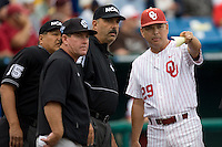Oklahoma's coach Sonny Golloway and USC's Ray Tanner meet with the umpires before Game 3 of the NCAA Division One Men's College World Series on Sunday June 20th, 2010 at Johnny Rosenblatt Stadium in Omaha, Nebraska.  (Photo by Andrew Woolley / Four Seam Images)