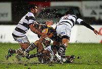 Taranaki's Paul Perez is wrapped up. Air New Zealand Cup rugby match - Taranaki v Auckland at Yarrows Stadium, New Plymouth, New Zealand. Friday 9 October 2009. Photo: Dave Lintott / lintottphoto.co.nz
