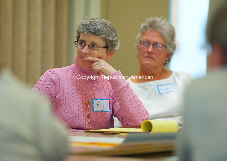 WOODBURY, CT--- -102615JS02---Woodbury residents Katy Sherer, left and Kippy West, right, listen as ideas being talked about during an Imagine Woodbury session with business owners, developers and residents Monday at the First Congregation Church in Woodbury. This session dealt with the Urban/Placemaking and Public Space. <br />  Jim Shannon Republican-American
