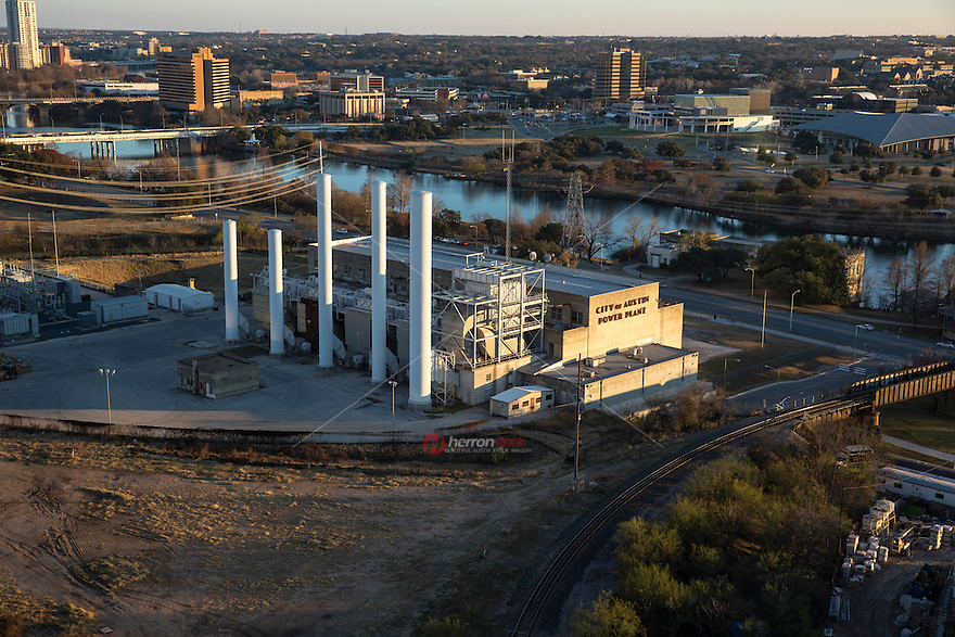 Aerial view of the City of Austin, Seaholm Power Plant with Lady Bird Lake in the background in downtown Austin, Texas.