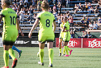 Seattle, WA - Sunday, April 17, 2016: Seattle Reign FC forward Merritt Mathias (9) celebrates her goal with teammates during the second half of the match at Memorial Stadium. Sky Blue FC defeated the Seattle Reign FC 2-1 during a National Women's Soccer League (NWSL) match at Memorial Stadium.