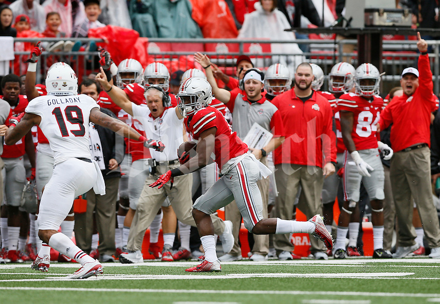 Ohio State Buckeyes cornerback Eli Apple (13) returns an interception along the sideline toward Northern Illinois Huskies cornerback Shawun Lurry (19) during the first quarter of the NCAA football game at Ohio Stadium in Columbus on Sept. 19, 2015. (Adam Cairns / The Columbus Dispatch)