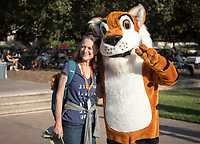 Anita Johnson P'21 poses for a photo with Oswald. Occidental College celebrates Homecoming and Family Weekend on Saturday, Oct. 14, 2017 at Oswald's Homecoming Party in the Academic Quad, featuring games, activity booths, a pub and food.<br /> (Photo by Marc Campos, Occidental College Photographer)