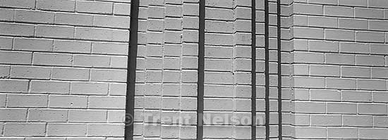 Brick wall. Pans around downtown.<br />