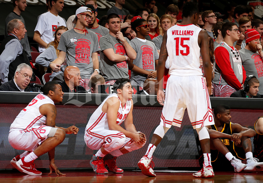 A.J. Harris (12) and Joey Lane (14) of the Ohio State Buckeyes wait to sub in as Kam Williams (15) leaves the game during Tuesday's NCAA Division I basketball game against Grambling State at Value City Arena in the Jerome Schottenstein Center in Columbus on November 17, 2015.  (Barbara J. Perenic/The Columbus Dispatch)