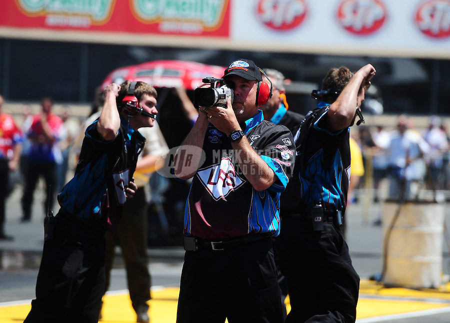 Jul. 31, 2011; Sonoma, CA, USA; Crew members for NHRA funny car driver Tim Wilkerson celebrate a win during the Fram Autolite Nationals at Infineon Raceway. Mandatory Credit: Mark J. Rebilas-