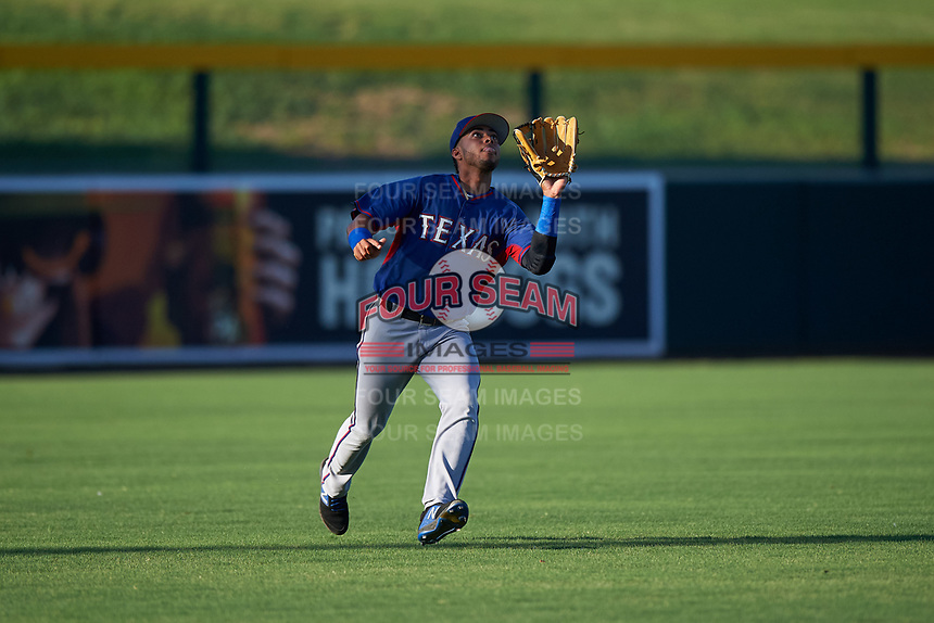 AZL Rangers left fielder William Jeffry (12) prepares to catch a fly ball during an Arizona League game against the AZL Athletics Gold on July 15, 2019 at Hohokam Stadium in Mesa, Arizona. The AZL Athletics Gold defeated the AZL Rangers 9-8 in 11 innings. (Zachary Lucy/Four Seam Images)