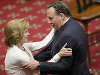 CAQ leader Francois legault gives his condolences to Lisette Lapointe, wife of former Quebec premier Jacques Parizeau, as her husband lies in state at the National Assembly in Quebec City on Sunday June 7, 2015.<br /> <br /> PHOTO :  Francis Vachon - Agence Quebec Presse