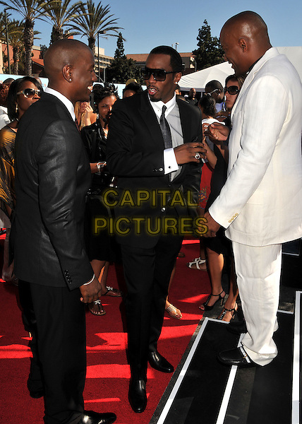 "TYRESE GIBSON, SEAN ""DIDDY"" COMBS & JOHN SINGLETON.2009 BET Awards - Arrivals held at the Shrine Auditorium, Los Angeles, CA, USA..June 28th, 2009.full length puff daddy black white suit sunglasses shades profile .CAP/ADM/BP.©Byron Purvis/AdMedia/Capital Pictures."