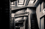 Looking down the staircase at the Lands Department Building in Sydney, NSW, Australia. The tower features a copper onion-shaped dome.<br /> <br /> Architect: James Barnet.