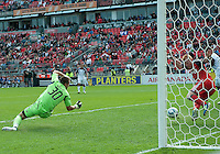 17 September 2011: Toronto FC defender Richard Eckersley #27 saves a ball from going into the net as Toronto FC goalkeeper Milos Kocic #30 watches during a game between the Colorado Rapids and Toronto FC at BMO Field in Toronto..Toronto FC won 2-1.