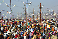 "India. Uttar Pradesh state. Allahabad. Maha Kumbh Mela. Indian Hindu devotees on the day of Mauni Amavasya Snan (Royal bath for Dark moon). The ritual ""Royal Bath"" is timed to match an auspicious planetary alignment, when believers say spiritual energy flows to earth. The Kumbh Mela, believed to be the largest religious gathering is held every 12 years on the banks of the 'Sangam'- the confluence of the holy rivers Ganga, Yamuna and the mythical Saraswati. In 2013, it is estimated that nearly 80 million devotees took a bath in the water of the holy river Ganges. The belief is that bathing and taking a holy dip will wash and free one from all the past sins, get salvation and paves the way for Moksha (meaning liberation from the cycle of Life, Death and Rebirth). Bathing in the holy waters of Ganga is believed to be most auspicious at the time of Kumbh Mela, because the water is charged with positive healing effects and enhanced with electromagnetic radiations of the Sun, Moon and Jupiter. The Maha (great) Kumbh Mela, which comes after 12 Purna Kumbh Mela, or 144 years, is always held at Allahabad. Uttar Pradesh (abbreviated U.P.) is a state located in northern India. 10.02.13 © 2013 Didier Ruef"