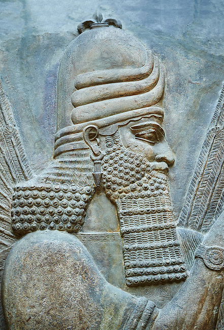 Stone relief sculptured panel of a Genie Blessing. Facade N. Inv AO 19865 from Dur Sharrukin the palace of Assyrian king Sargon II at Khorsabad, 713-706 BC.  Louvre Museum Room 4 , Paris