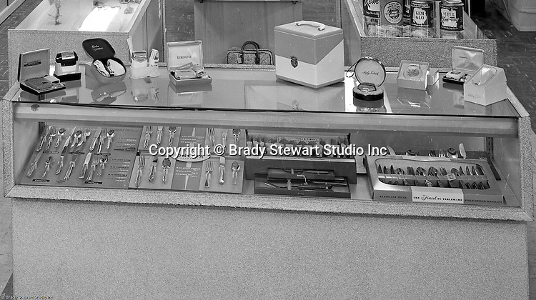 Client: Eiben and Irr Company<br /> Ad Agency:  Eiben and Irr Marketing<br /> Products: Department Store items<br /> Location: Wood Street and Liberty Avenue in Pittsburgh<br /> <br /> Location photography for Eiben and Irr's Holiday Catalog. New silverware &amp; women's razors for sale at Eiben and Irr Department Store.  Eiben and Irr Jewelry and Department Store operated in downtown Pittsburgh at the corner of Wood Street and Liberty Avenue from 1953-1979.