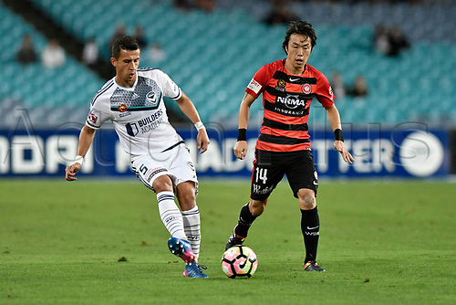 April 8th 2017, ANZ Stadium, Sydney, Australia; A-League football, Western Sydney Wanderers versus Melbourne Victory; Victory defender Daniel Georgievski passes the ball whilst Wanderers midfielder Jumpei Kusukami closes in; The match  ended in a 0-0 draw;