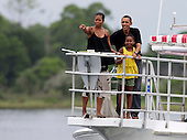 United States President Barack Obama, first lady Michelle Obama and daughter Sasha tour St. Andrews Bay on the Bay Point Lady, Sunday, August 15, 2010 In Panama City Beach, Florida. The First Family is visiting the area to help promote tourism and check up on cleanup efforts from the aftermath of the Deepwater Horizon Oil spill. .Credit: Mark Wallheiser - Pool via CNP