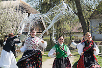 Local young men splash water at women as part of the traditional folklore Easter celebration during a press event in the Skansen open air ethnographic museum in Szenna (about 200 km South-West of capital city Budapest), Hungary on April 19, 2019. ATTILA VOLGYI