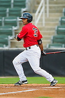 Micah Johnson (37) of the Kannapolis Intimidators follows through on his swing against the Delmarva Shorebirds at CMC-Northeast Stadium on April 15, 2013 in Kannapolis, North Carolina.  The Shorebirds defeated the Intimidators 8-4.  (Brian Westerholt/Four Seam Images)