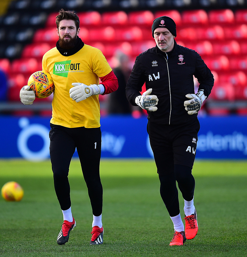 Lincoln City's Josh Vickers, left, and Lincoln City's first team goalkeeping coach Andy Warrington during the pre-match warm-up<br /> <br /> Photographer Andrew Vaughan/CameraSport<br /> <br /> The EFL Sky Bet League Two - Lincoln City v Northampton Town - Saturday 9th February 2019 - Sincil Bank - Lincoln<br /> <br /> World Copyright © 2019 CameraSport. All rights reserved. 43 Linden Ave. Countesthorpe. Leicester. England. LE8 5PG - Tel: +44 (0) 116 277 4147 - admin@camerasport.com - www.camerasport.com