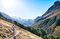 Trail running on the Europaweg and entering the Tasch Valley, while on the Via Valais, a multi-day trail running tour connecting Verbier with Zermatt, Switzerland.