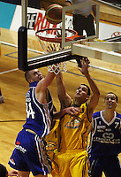Saints centre Calum McLeod beats Weli Paurini to score during the NBL Round 9 match between the Wellington Saints and Nelson Giants at TSB Bank Arena, Wellington, New Zealand on Thursday 7 May 2009. Photo: Dave Lintott / lintottphoto.co.nz