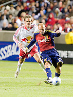 Real Salt Lakes forward Clint Mathis (84) and New York Red Bulls defender Kevin Goldthwaite (2) go up for a header during the Real Salt Lake vs New York Red Bulls 1-1 draw at Rio Tinto Stadium in Sandy, Utah. Photo by Eric Salsbery/isiphotos.com
