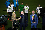 Dover Athletic 2 Cambridge United 4, 17/11/2016. The Crabble, FA Cup first round replay. Home players walking off the pitch as visiting manager Shaun Derry is interviewed live on television at the Crabble after National League Dover Athletic hosted League 2 Cambridge United in an FA Cup first round replay. The club was founded in 1983 after the dissolution of the town's previous club Dover FC, whose place in the Southern League was taken by the new club. Cambridge United won the tie by 4-2 after extra time, watched by a crowd of 1158. Photo by Colin McPherson.