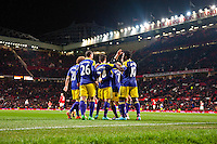 Sunday 05 January 2014<br /> Pictured:Swans Players celebrate Bony's winning goal<br /> Re: Manchester Utd FC v Swansea City FA cup third round match at Old Trafford, Manchester