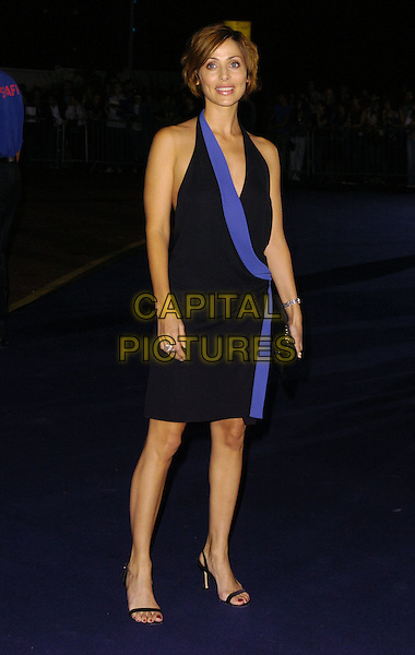 NATALIE IMBRUGLIA.At the Giorgio Armani RED One Night Only .Fashion & Music Party, Earls Court, .London, England, September 21st 2006..full length black and blue halterneck wrap around over dress strappy sandals shoes.Ref: CAN.www.capitalpictures.com.sales@capitalpictures.com.©Can Nguyen/Capital Pictures