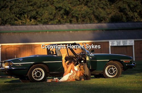 Royal Ascot Horse Racing. Couple having open air sex in the No 1 car park. Circa 1985
