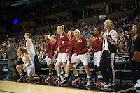 SPOKANE, WA - MARCH 30, 2013: The Cardinal bench cheers their teammates during the third round NCAA Championships game matching Stanford vs Georgia at the Spokane Arena. The Cardinal fell to the Bulldogs 61-59.