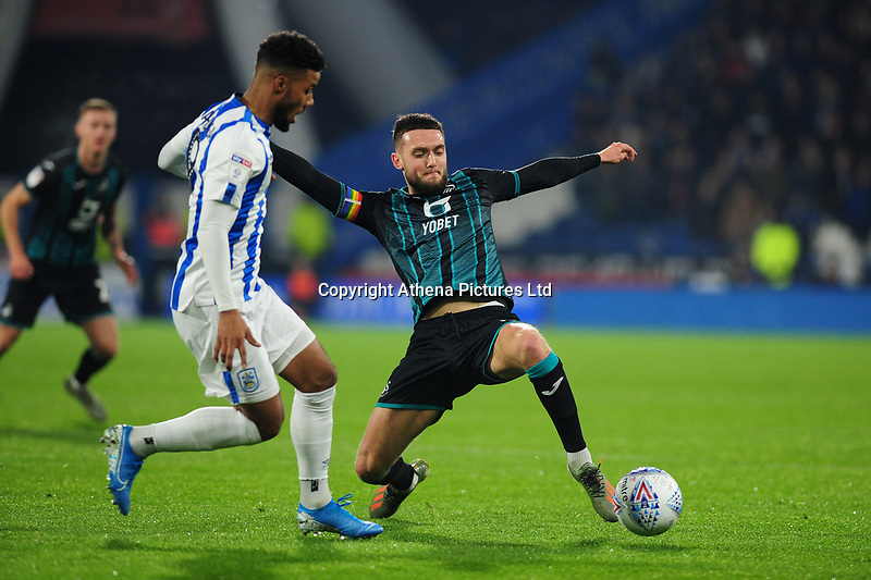 Matt Grimes of Swansea City in action during the Sky Bet Championship match between Huddersfield Town and Swansea City at The John Smith's Stadium in Huddersfield, England, UK. Tuesday 26 November 2019