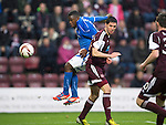 Hearts v St Johnstone....02.11.13     SPFL<br /> Nigel Hasselbaink gets above Ryan McGowan to open the scoring<br /> Picture by Graeme Hart.<br /> Copyright Perthshire Picture Agency<br /> Tel: 01738 623350  Mobile: 07990 594431