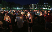 Thousands of UVa students, faculty and Charlottesville residents led a candle light march across grounds Wednesday night in Charlottesville, Va. The march was an effort to stomp out the hate across campus from last Friday's torch march. Photo/Andrew Shurtleff/The Daily Progress