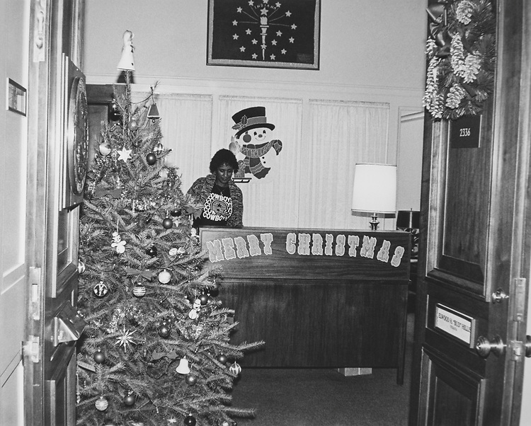 Decorated office of Rep. Elwood Hillis, R-Ind., during Christmas contest in 1983. Staff member at reception desk. (Photo by CQ Roll Call via Getty Images)